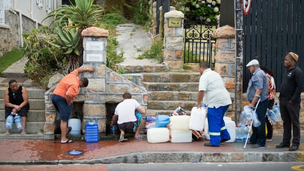 People in Cape town retrieving water at a public water tap