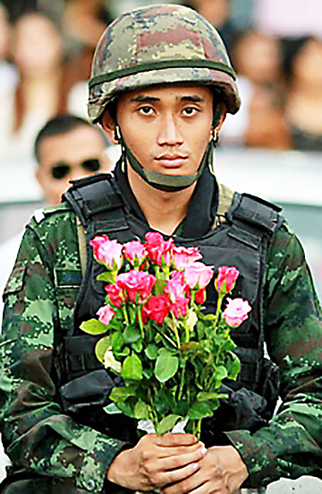 soldier holding flowers