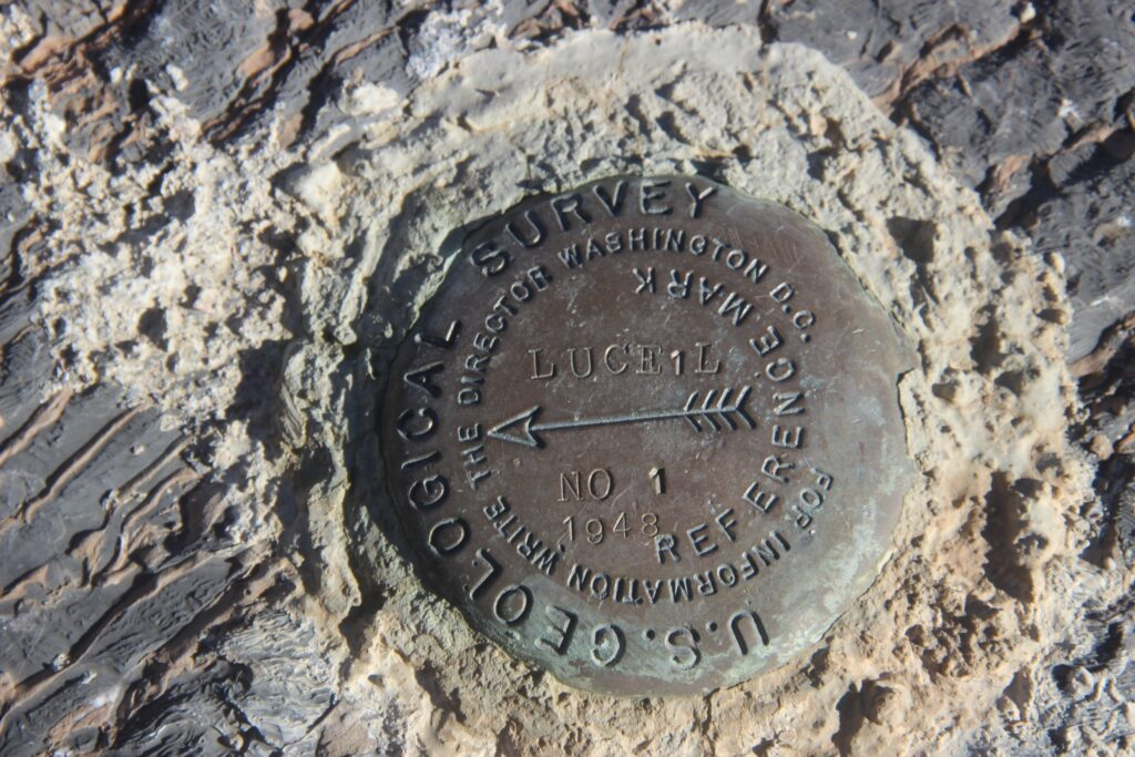 USGS metal marker embedded in stone in Inyo County, CA.