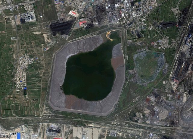 Satellite image of an industrial waste holding pond.