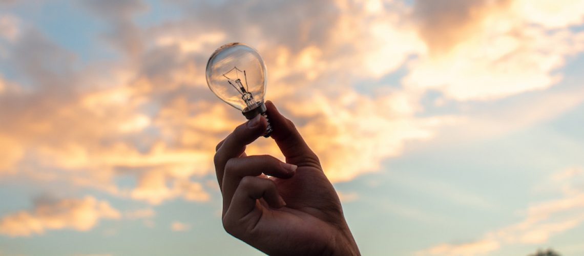 Canva - Person Holding Clear Light Bulb